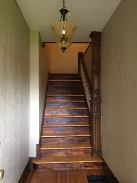 After Refinishing Hardwood Stairwell